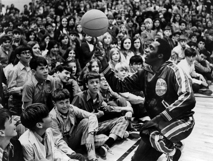 Lemon's moves were a highlight of the traveling basketball show for nearly a quarter-century.Meadowlark Lemon of the Harlem Globetrotters spun a basketball for admiring fans in 1972.