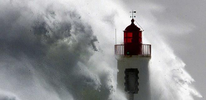 wave lighthouse   wave hits a lighthouse at the entrance of Les Sables D\'Olonne ...