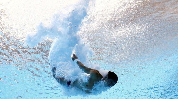 Qiu Bo de China compite en el Maria Lenk centro acuático - Río de Janeiro…