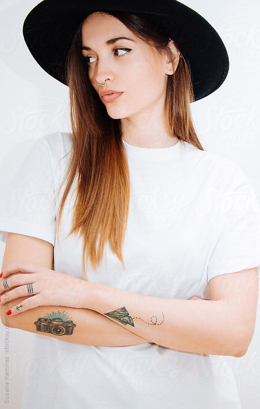 Young woman with black hat by Susana Ramírez for Stocksy United