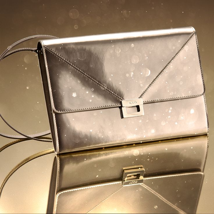A tiny bag for the greatest style: Tod's mini D-Cube shoulder bag in silvery leather. Shop now: www.tods.com/gift-ideas #tods #christmas #todswinterholidays