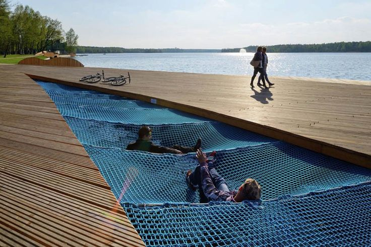 Nets for lying in become a unique attraction at this waterfront walkway