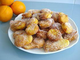 BUÑUELOS DE NARANJA   * 1 naranja entera  * 3 huevos  * 1 yogurt  * 1 cucharada de aceite  * Una pizca de sal  * 200 gr. de harina  * 1 so...