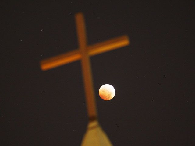 Blood Moon Pictures - Beautiful Photos of the October 2014 Blood Moon - Woman's Day Being all celestial behind a church in California