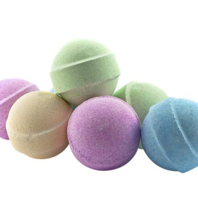 Add drops of food coloring to make bath bombs colorful.