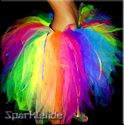 This tutu fades all the colors of the rainbow. It is cut at an angle (longer in the back).And, has UV Neon rainbow fabric strips throwout the tulle:)    Tulle glows in the black light:) I want to be rainbow bright next halloween
