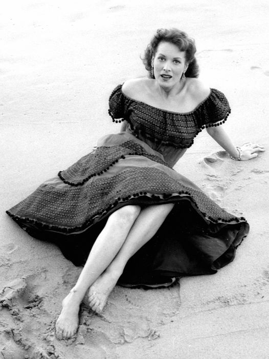 This 1955 photograph features Maureen O'Hara in Portugal during the filming of Lisbon. Lisbon is a 1956 American crime film produced and directed by Ray Milland and starring Milland, Maureen O'Hara, Claude Rains, Edward Chapman, and Jay Novello.: