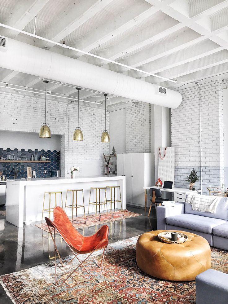fireclay tile, leather ottoman, persian rug, midcentury modern, global glam living room, open living room kitchen, rejuvenation brass lighting, modern kitchen