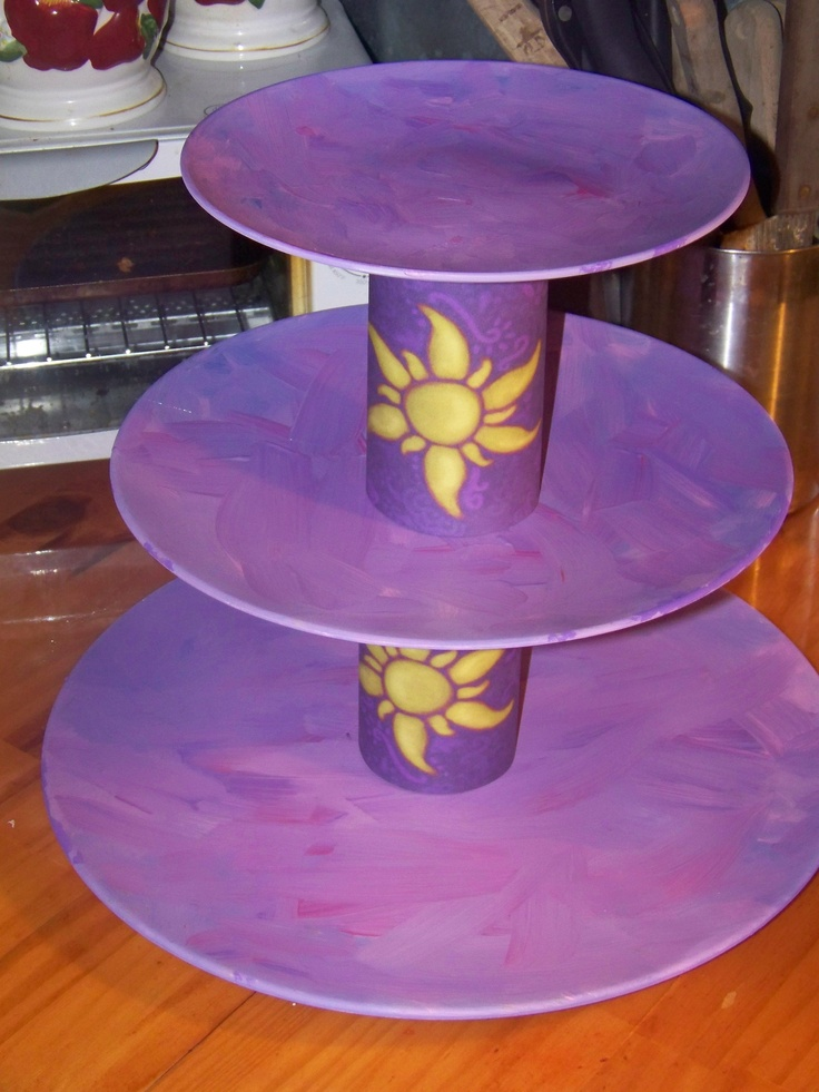tangled themed cupcake stand made out of $1 walmart plates and gravy jars covered with card stock