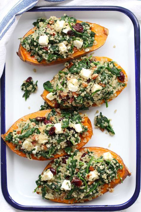 Roasted sweet potatoes stuffed with quinoa and spinach are a favorite fall dish. It's colorful, healthy and packed with flavor.  Green Valley Kitchen.