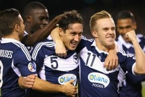 Melbourne Victory have kept their Asian Champions League (ACL) dreams alive with a 2-0 win over reigning champions Guangzhou Evergrande.