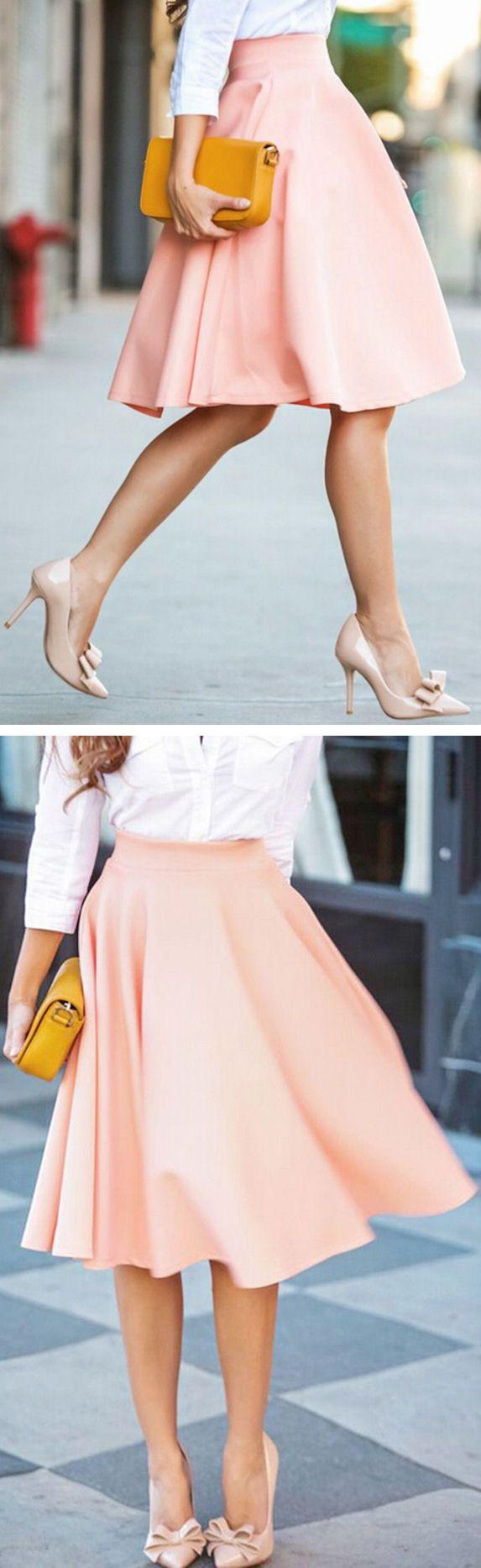 Light pink skirt, white shirt, nude heels.
