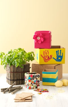 Dozens of materials allow you to dress up your cardboard gardening projects to suit your taste.