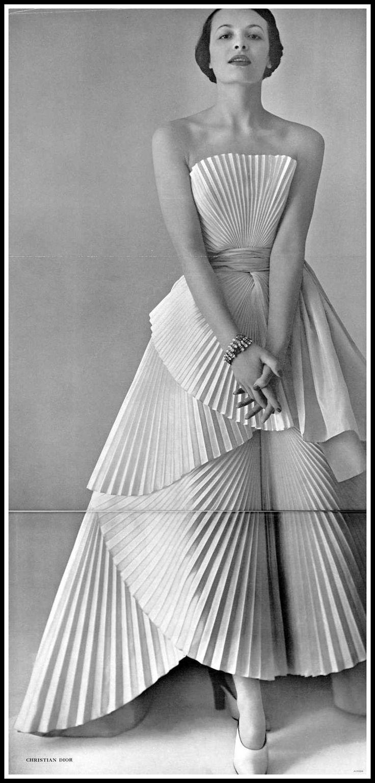 Model in Christian Dior's pleated taffeta fan dress, photo by Pottier, 1950