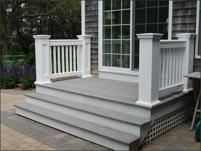 "Jamestown Stairway Railing -  Secure and stylish without pretention, the matching back yard stairway railing has 8"" recessed panel newels with handsome cap and base."