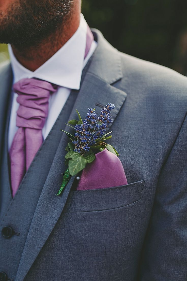 An elegant grey three piece suit with pinky purple neck tie and pocket square plus gorgeous lavender buttonhole  Photo by Benjamin Stuart Photography #groomsmen #buttonhole #suit