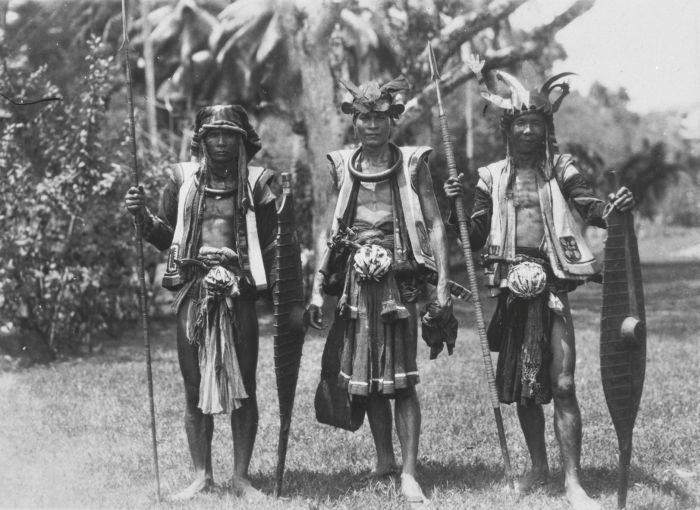 Indonesia - Sumatra, Nias | 3 Warriors / soldiers at Hilisimaetano. ca. 1925 - 1938. | Photographer unknown