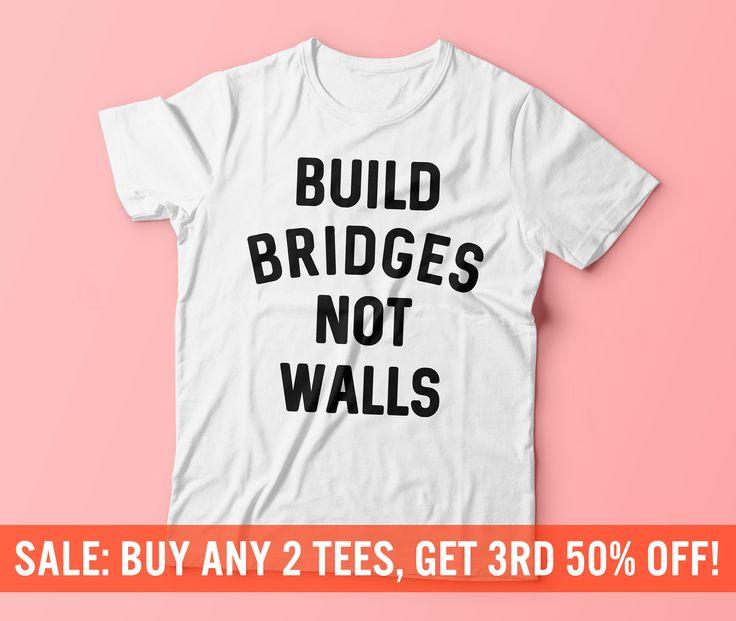 Build Bridges Not Walls Shirt   Love Trumps Hate Tee   Anti-Trump T-Shirt   Hillary Clinton Tee   Vote Hillary   Unisex Mens Womens T-Shirt by TeeTuna on Etsy https://www.etsy.com/listing/462748461/build-bridges-not-walls-shirt-love