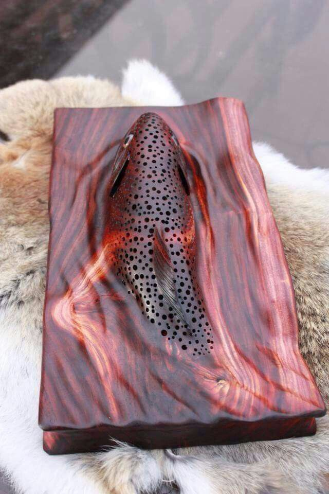 Beautiful wood carving of a fish in water