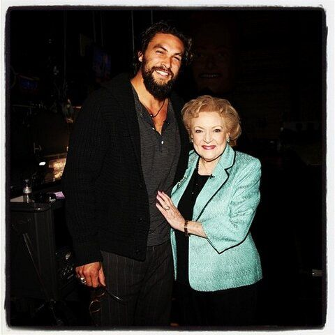 Betty White couldn't help but touch Jason. I don't blame her.