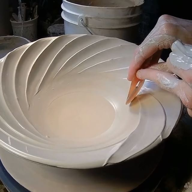 """Spiral slip in detail- The song is """"Hero"""" by @familyoftheyear. Sometimes when I'm throwing, I'll just put this song on repeat, it's so pretty, and I find the lyrics so meaningful.  Here's what I'm doing in the video-- Previously I'd made a video that showed throwing a bowl, and then adding slip to the rim to create a spiral effect.  In this video I'm focusing just on the slip application, at a slower speed so you can get a better look at it.  After the bowl has set up over night, I add…"""