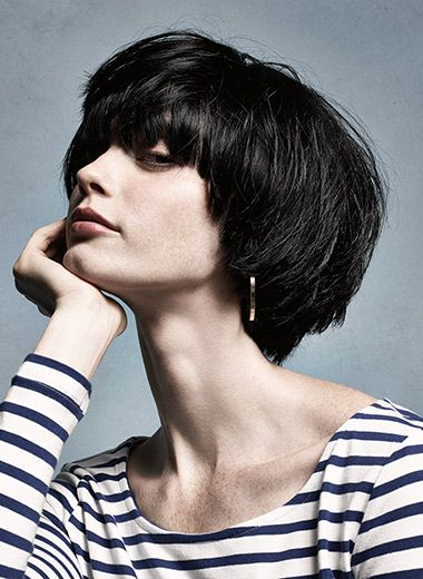 The Look: Rising Tide. Apply Tonic Lotion to damp hair, then blow-dry with hands until hair is 70% dry. Spritz on Surf Infusion, then finish the blow dry with a flat brush. Apply Surf Spray at the root and blow-dry the product into hair for added volume. #shorthair #texture #beachy #brunette #bangs