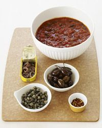 Puttanesca Sauce: garlic + crushed red pepper + tomato paste + whole peeled tomatoes + basil + kalamata olives + capers