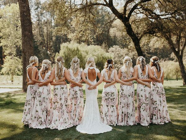 Totally loving these floral bridesmaid dresses by Beach Riot | Jordan Voth Photography