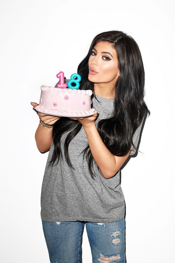 Kylie Jenner holding 18 birthday cake for photo shoot