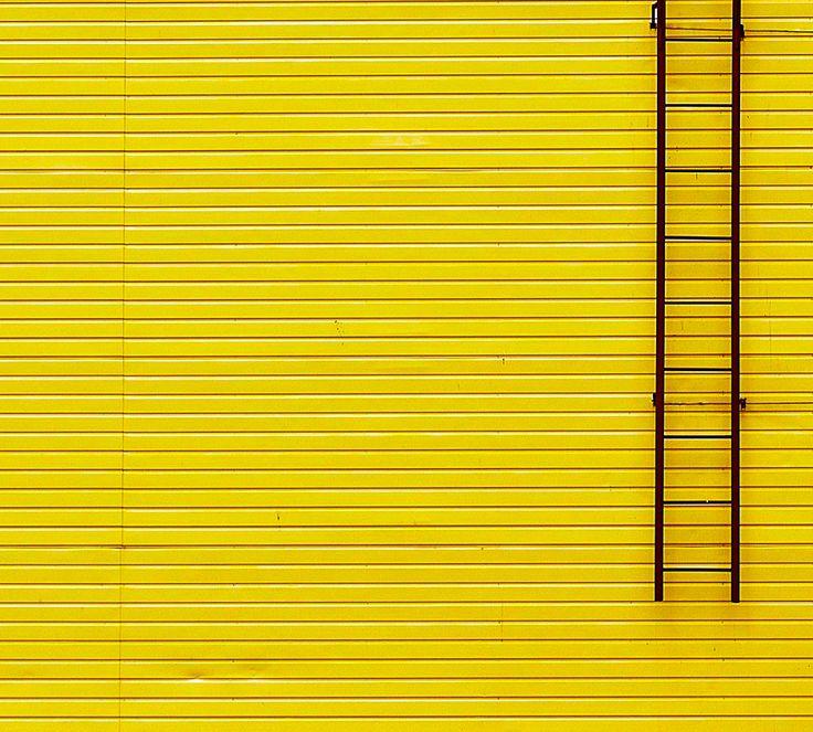 Yellow Wall and Ladder by Gleb Potapenko