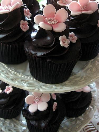 Dark chocolate cupcake with pink marzipan flowers... so pretty!