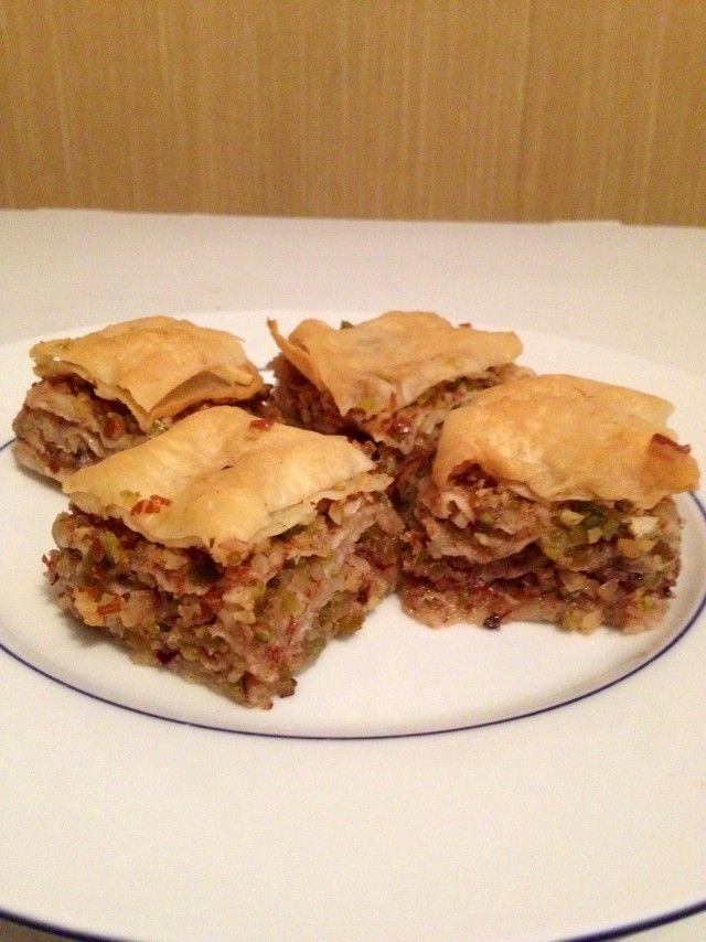 Baklava with homemade Fillo pastry, filled with unblanched almonds, walnuts and pistachios, soaked in a honey, lavander, cinnamon and cloves syrup. This is the first time I made Baklava and I think I'll prepare it again. Yummy!!!  Submitted by Acer