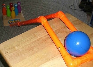 special needs bowling ramp: diy tutorial - Re-pinned by #PediaStaff.  Visit http://ht.ly/63sNt for all our pediatric therapy pins