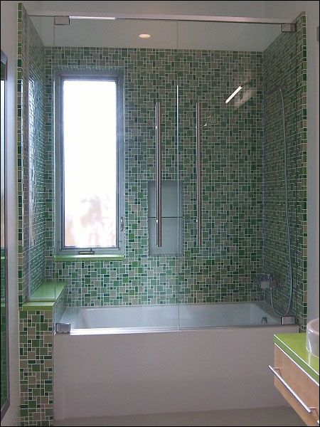 Glass enclosure and window in tub