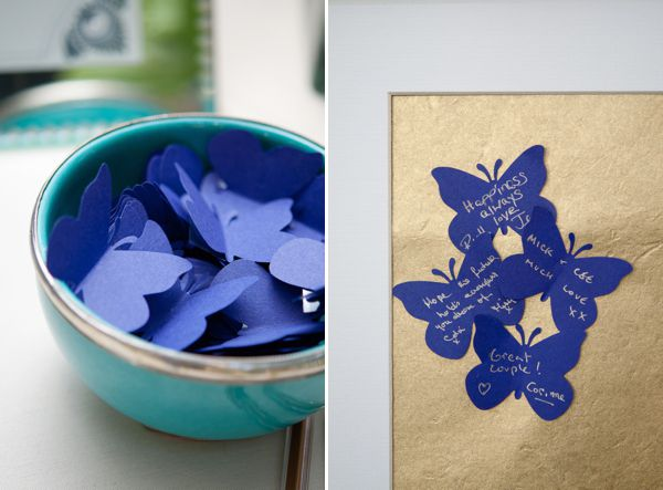 Butterfly cut-out guest book  http://www.sarareeve.com/