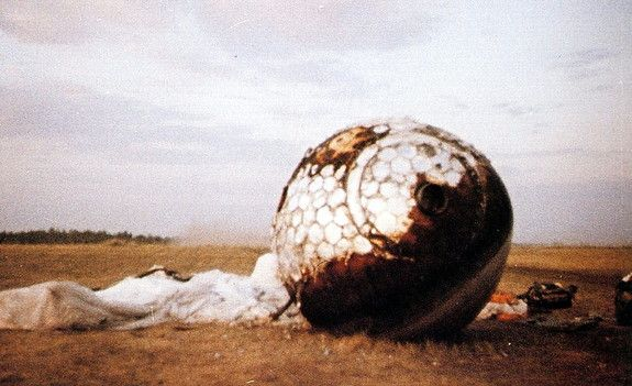 Credit: ESAHere the re-entry capsule of the Vostok 3KA-3 (also known as Vostok 1) spacecraft (Vostok 1) is seen with charring and its parachute on the ground after landing south west of Engels, in the Saratov region of southern Russia.