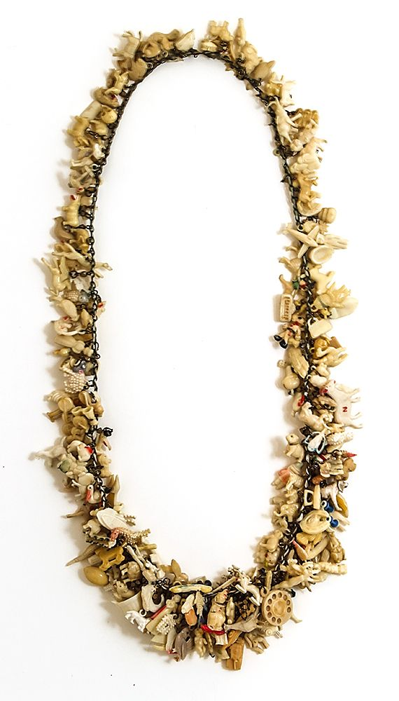 """Robin Ayres – Hundreds of vintage celluloid charms – This is my personal collection necklace. I add unusual charms to it as I find them. It lacks the """"engineering"""" of my other pieces because it is constantly changing."""