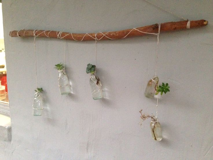 Outside mobile/hanging vase made with small found glass bottles, string and a gum tree stick. Thanks to Pascale!