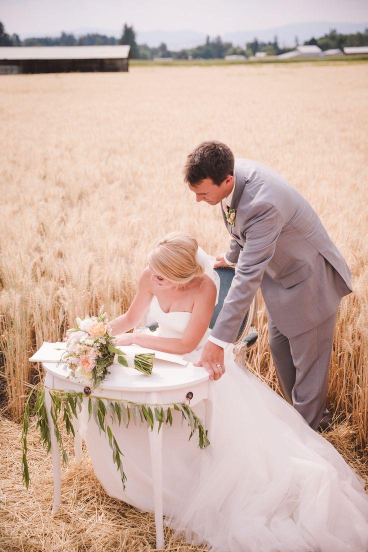 #wheatfield  #ceremony #ceremonydecor #wheat #ceremonyseating #barn #wedding #barn wedding #okanagan #rustic #barnwood #signingtable #bouquet #bridalbouquet