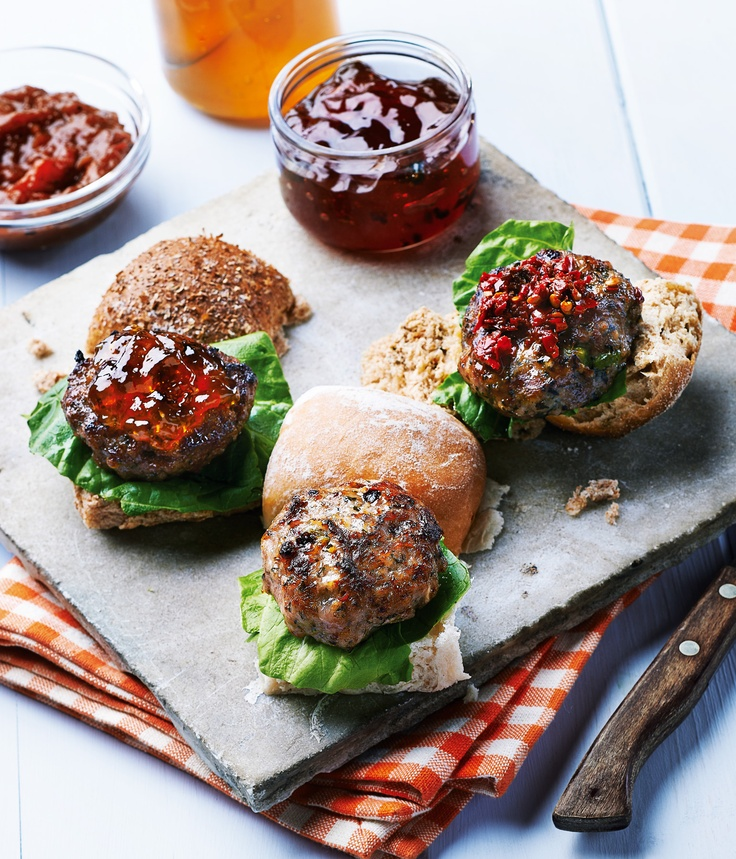 mini burgers and buns with different relishes on a piece of slate shot for great - Slate Cafe Ideas