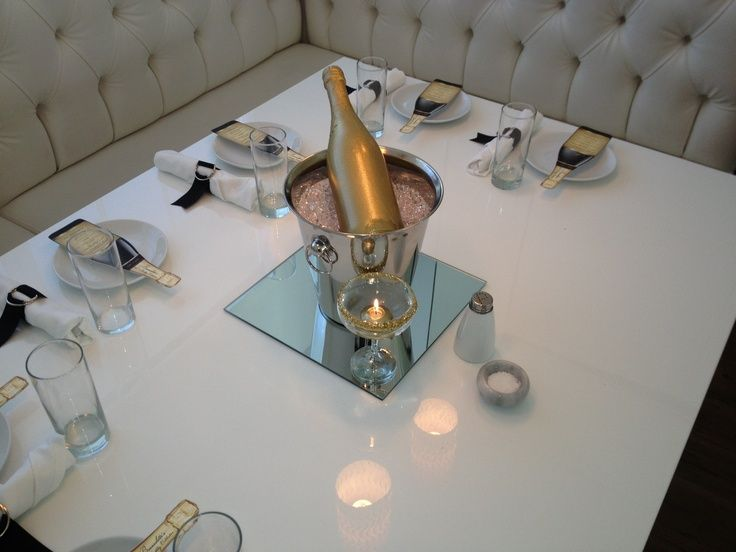 Centerpiece ice bucket - spray painted champagne bottle in acrylic ice.