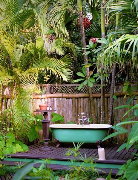 A green bathtub in a green garden.. Just add flowers in the bath and you're in for a tropical dream treat! Plants and trees can contribute to your wellbeing, simply by providing lots of oxygen for you to bathe in. More here: https://www.maskfragrances.com/products/mask-toilet-spray-coconut-lime #ilovebathroomideas #inspiration #dreamhouse #apartmenttherapy #interiorinspiration #liveauthentic #giftideas #bathroompics