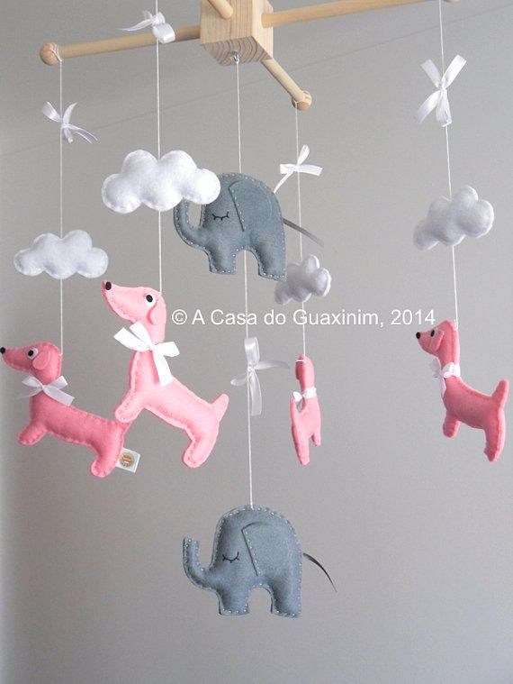 This nursery mobile is perfect to decorate your babys room, above a bed, or as a baby shower gift. Hangs 4 handmade Dachshunds and 2 Elephants