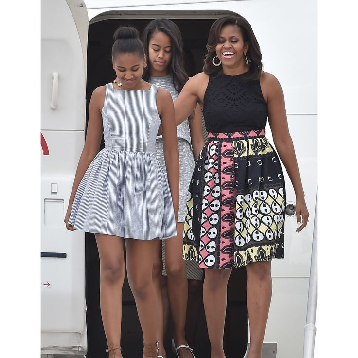 MILAN, ITALY - JUNE 17: First Lady Michelle Obama arrives with daughters Malia Obama (C) and Sasha Obama (L) at Malpensa Airport on June 17, 2015 in Milan, Italy. (Photo by Jacopo Raule/Getty Images)