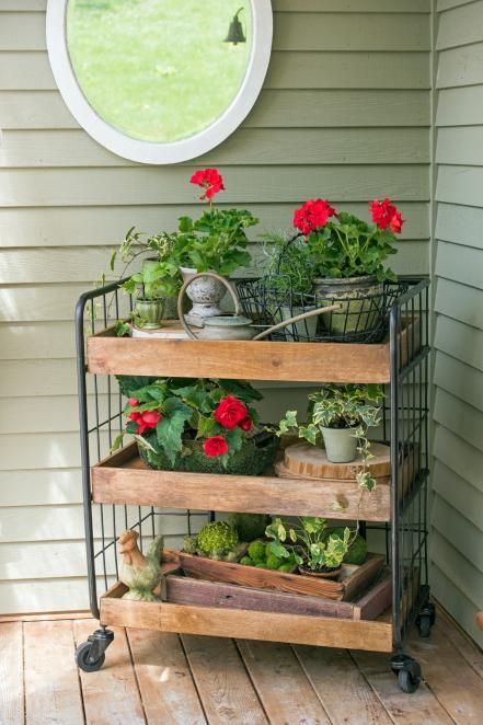 Place a rolling cart to your front porch and add a mix of seasonal decorating pieces, potted plants and flowers. Update the look each season by changing out a few pieces and you'll be able to use the cart year round.