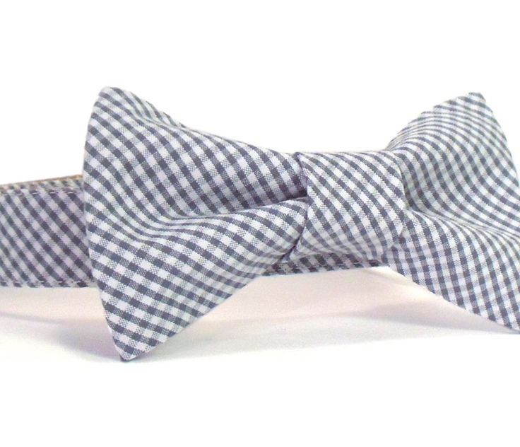 A classic gingham dog collar and matching bow tie in a charcoal gray cotton. The removable bow tie is lined with interfacing to help keep its shape and attaches to the collar with velcro strips at two points so it remains straight and stylish at all times. All the parts come together to make one heck of a strong (yet comfortable) collar. This collar features: - YKK plastic buckle — the strongest side-release buckle available and contoured to fit the curve of your pup's neck. - Soft to the…