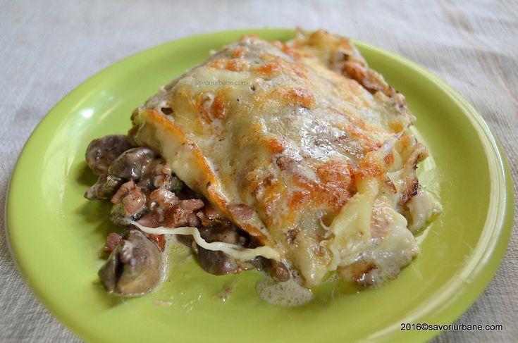 Clatite cu ciuperci si sunca gratinate la cuptor. O reteta simpla de clatite aperitiv umplute cu bucatele de sunca afumata si ciuperci sotate, cascaval si