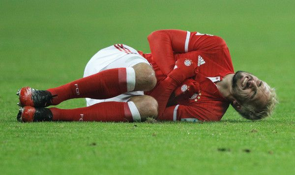 Mats Hummels Photos Photos - Mats Hummels of Bayern Muenchen goes down injured during the Bundesliga match between Bayern Muenchen and RB Leipzig at Allianz Arena on December 21, 2016 in Munich, Germany. - Bayern Muenchen v RB Leipzig - Bundesliga