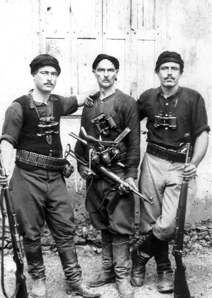 Cretan partisans pose for a photograph following the Axis invasion of the island. For the first time during war, German forces faced in Crete a valiant resistance from the local civilian population when they invaded in May 1941. Civilians on Crete, men, women & even children, picked off Axis paratroopers or attacked them with knives, axes, scythes, clubs or even bare hands in a show of resistance that would become legendary.