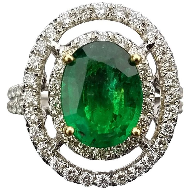 White Gold Oval Zambian Emerald and Diamond Cocktail Ring | From a unique collection of vintage cocktail rings at https://www.1stdibs.com/jewelry/rings/cocktail-rings/